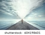 man walking between two seas | Shutterstock . vector #604198601