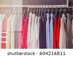 women clothes on racks in a... | Shutterstock . vector #604216811