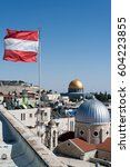 Small photo of Jerusalem, Israel - February 25, 2017: Austrian flag on the Austrian hospice with the view on the Dome of the Rock and dome of the Church of St. Mary of agony