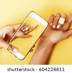 womans hand taking picture of... | Shutterstock . vector #604228811