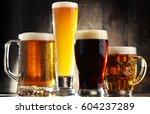 four glasses of beer on wooden... | Shutterstock . vector #604237289