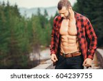 handsome fit man posing... | Shutterstock . vector #604239755