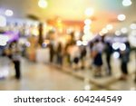 blurred people at shopping mall ... | Shutterstock . vector #604244549