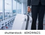 businessman and suitcase in the ...   Shutterstock . vector #604244621