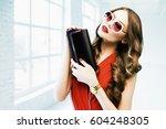 young beautiful fashionable... | Shutterstock . vector #604248305