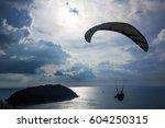 Silhouette Of Parachutist...