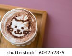 coffee cup with artistic cream... | Shutterstock . vector #604252379