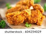 fried chicken wings on wooden... | Shutterstock . vector #604254029