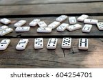 Dominoes On A Table Scattered...