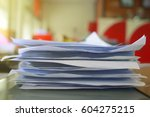 paper documents stacked in... | Shutterstock . vector #604275215