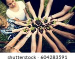 people hands cupping plant... | Shutterstock . vector #604283591