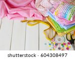 rolls of colored fabric on a... | Shutterstock . vector #604308497