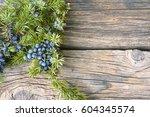 juniper berries on vintage... | Shutterstock . vector #604345574