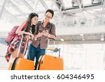 asian couple travelers using... | Shutterstock . vector #604346495