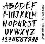 hand drawn brush font.... | Shutterstock .eps vector #604365359