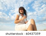 young woman with bottle of water outdoors - stock photo