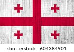 georgia flag on wood texture... | Shutterstock . vector #604384901