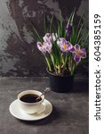on the table is a cup of coffee ... | Shutterstock . vector #604385159