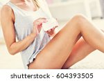 picture of a fit woman holding... | Shutterstock . vector #604393505