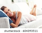 happy woman resting at home | Shutterstock . vector #604393511