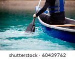 A Person Paddling A Canoe In A...