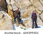 group of climbers reaches the... | Shutterstock . vector #604399301