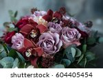 Stock photo a bouquet of roses in a wooden vase is on the table flower arrangement in a wooden flowerpot 604405454