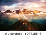 a look at the sunlit hills at... | Shutterstock . vector #604418849
