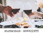 happy romantic couple cheering... | Shutterstock . vector #604422395
