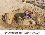 An Artist Building A Sand...