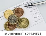 Small photo of account statement and coins