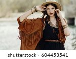 stylish hipster woman posing in ... | Shutterstock . vector #604453541