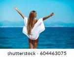 cheerful tanned woman in bikini ... | Shutterstock . vector #604463075