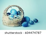 Easter background with eggs in basket.