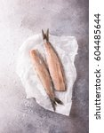 Stock photo freshly salted herring on gray background with copy space traditional dutch delicacy retro style 604485644