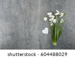 Bouquet Of Snowdrops On Gray...