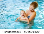 Mother And Baby Swim  In The...