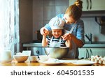 happy family in the kitchen.... | Shutterstock . vector #604501535