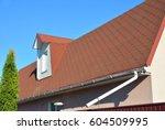 roof asphalt shingles with moss.... | Shutterstock . vector #604509995