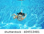 child swims in pool under water ... | Shutterstock . vector #604513481