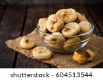 dried figs in glass bowl on... | Shutterstock . vector #604513544