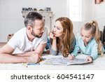 young family of three drawing... | Shutterstock . vector #604541147