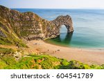 durdle door at the beach on the ...   Shutterstock . vector #604541789