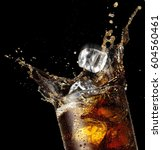 Cola Glass With Falling Ice...