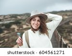 adventure woman with curly... | Shutterstock . vector #604561271