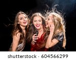 three gorgeous young women in... | Shutterstock . vector #604566299