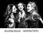 black and white photo of three... | Shutterstock . vector #604567691