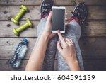 female fitness or sport concept.... | Shutterstock . vector #604591139