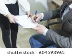 businessman in suit signing a... | Shutterstock . vector #604593965