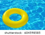 colorful inflatable tube... | Shutterstock . vector #604598585